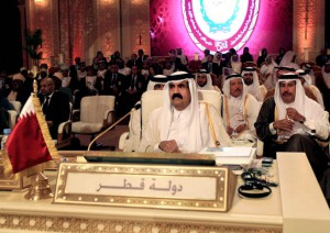 Emir of Qatar Sheik Hamad Bin Khalifa Al Thani, center, attends the opening session of the Arab League Summit in Doha, Qatar, Tuesday, March 26, 2013. Photo: AP