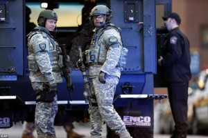 "Militarized police stand around aimlessly before and after the blasts in Boston - exposing the ""safety"" offered to the public in the last 10 years by the growing police state as a mere illusion we have been made to accept, but clearly, to no avail. (AP)"