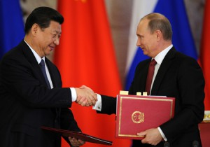 China's President Xi Jinping (L) and his Russian counterpart Vladimir Putin (R) after talks in Moscow, March 23, 2013.