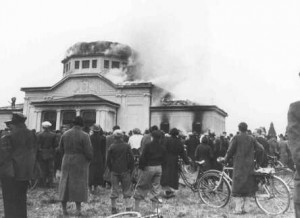 Local residents watch the burning of the ceremonial hall at the Jewish cemetery in Graz during Kristallnacht, November 1938