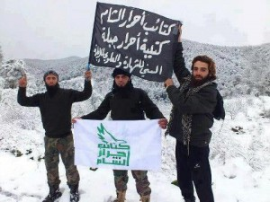 "The black sign includes the words ""Genocide for Alawites."" The long unkept beard with shaven upper lip (see two men on left) is a tell-tale Wahhabi/Salafi look."