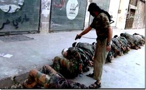 A Jabhat al-Nusrah fighter executes Shia Alawites in Syria.