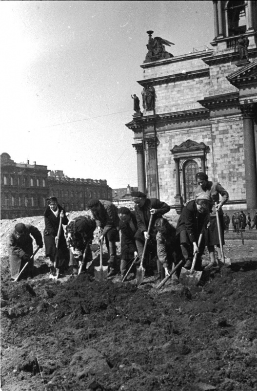 City residents are digging the ground in front of Isaak Cathedral to plant vegetables