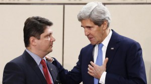 Romanian Foreign Minister Titus Corlatean listens to U.S. Secretary of State John Kerry, Brussels, December 3, 2013