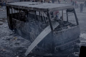 "Ukraine's ""peaceful pro-European"" protesters leave a burnt land behind. Photo of a burnt police bus taken by S.Morgunov at the Euromaidan on January 20, 2014"