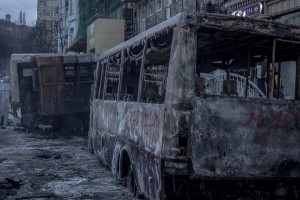 "Police buses burnt by ""peaceful pro-European protesters"" in Kyiv. Photo taken on January 20, 2014."