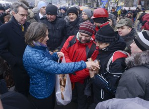 US Assistant secretary of State Victoria Nuland distributing cakes to protesters on the Independence Square in Kiev on December 10, 2013.