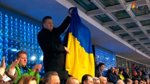 President of Ukraine Victor Yanukovych waving national flag as the Ukrainian team advanced to the stadium during Opening ceremony, Sochi, February 7, 2014.