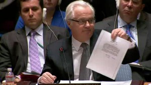 Amb. Vitaly Churkin shows a letter to the U.N. Security Council in New York purportedly from ousted Ukrainian leader Viktor Yanukovich to Vladimir Putin asking the Russian leader for military assistance in Ukraine.