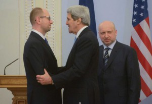 US Secretary of State John Kerry shaking hands of the members of the Ukrainian junta.