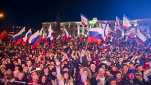 Thousands of Crimeans celebrating reunification with Russia on the central square of Simferopol.