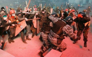 "Polish police academy ""students"" beating Berkut officer on Euromaidan in Kiev, January 2014."