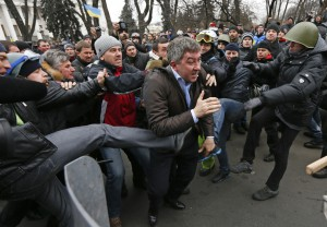 Party of Regions' delegate Vitaly Grushevsky being beaten at the entrance to Supreme Rada building, Kiev, February 21, 2014.