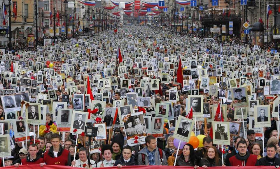 Victory Day [May 9] 2014. Nevsky Avenue, St.Petersburg, Russia. People demonstrating photos of their relatives who perished during the defense of the Northern capital in 1941-1944.