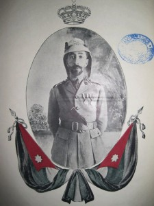 Faisal ibn al-Hussein (1885-1933), King of Iraq from 1921 to his death. Take note of the flag of Arab Kingdom of Syria, which crowned Faisal as its King in March of 1920 and collapsed under French conquest four months later.