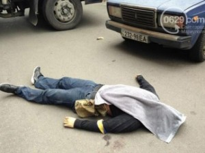 "A civilian victim of Ukrainian ""counter-terrorist operation"" in Mariupol, May 9, 2014."