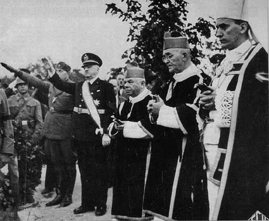 Ante Pavelic (left) raising hand in Nazi salutation during funeral of Marko Dosen, president of the Ustasha parliament, 1944.