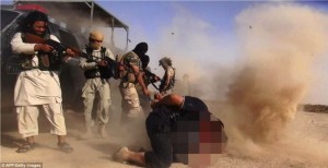 Islamic State of Iraq and the Levant militants executing members of the Iraqi forces on the Iraqi-Syrian border.