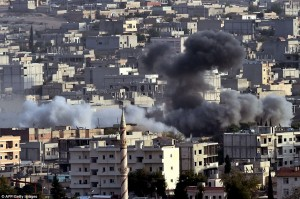 Smoke from an airstrike by the US-led coalition ascends in the Syrian town of Ain al-Arab, known as Kobane by the Kurds.