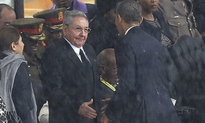 Barack Obama shakes hands with Cuba's President Raúl Castro at a memorial service for Nelson Mandela.