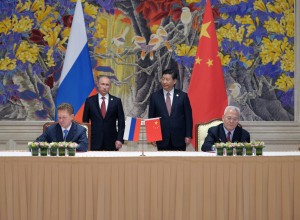 China signed a long-awaited, 30-year deal on May 21, 2014 to buy Russian natural gas worth 400 billion US dollars in a financial boost to the diplomatically isolated Russian President Vladimir Putin. [Russia's President Vladimir Putin, background left, and China's President Xi Jinping, background right, Russian Gazprom CEO Alexei Miller, foreground left, and China's CNPC head Zhou Jiping, foreground right]