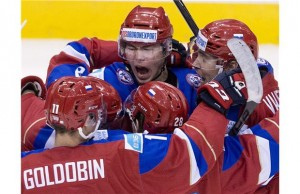 Russian U20 ice hockey team celebrates victory over Sweden in semifinal at the IIHF World Junior Championship in Toronto on Jan. 4, 2015. THE CANADIAN PRESS/Nathan Denette