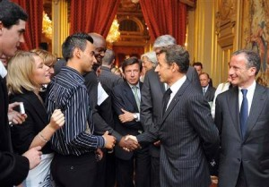 Nicolas Sarkozy, then French president, shaking hands with Amedy Coulibaly, a terrorist who killed one policeman and four shoppers in a kosher supermarket in Paris early January 2015. This handshake took place on July 15 2009, at an official event at the Elysee palace, organised to promote apprenticeships for youth.