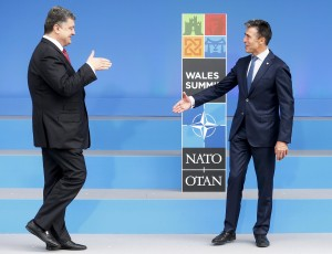 NATO Secretary-General Anders Fogh Rasmussen greets Ukranian President Petro Poroshenko at the start of the NATO summit at the Celtic Manor resort, near Newport