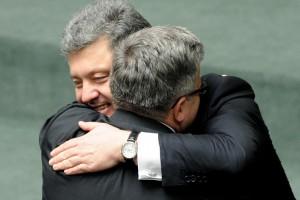 Petro Poroshenko hugs his Polish counterpart Bronislaw Komorowski
