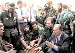 Bosnian Muslim President Alija Izetbegovic, lower right, meeting with Al-Qaeda linked Arab-Afghan mujahedeen in Bosnia.
