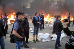 Alexey Goncharenko watching as ultra-nationalists are setting fire on protester's camp in Odessa, May 2, 2014