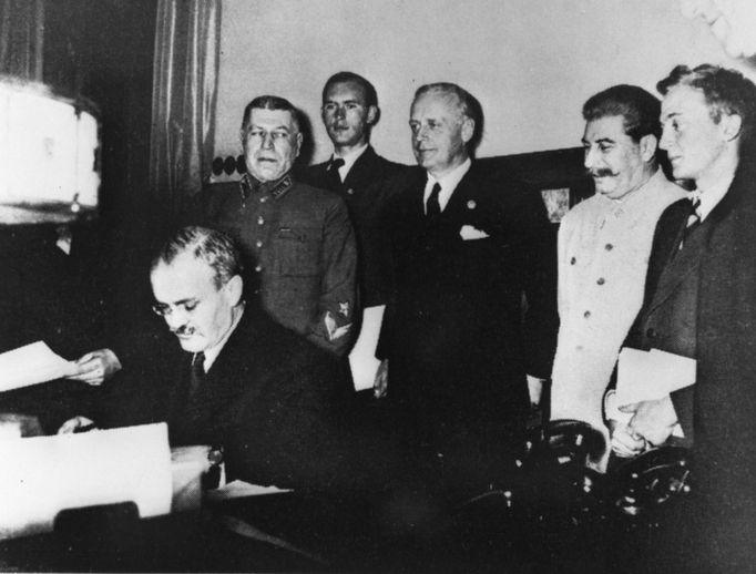 Soviet Foreign Commissar Vyacheslav Molotov signing Soviet-German Non-Aggression agreement on August 23, 1939.
