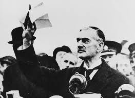 British prime minister Neville Chamberlain holding a copy of the supplemental British-German Declaration [1] by his plane after return from Munich, September 1938.