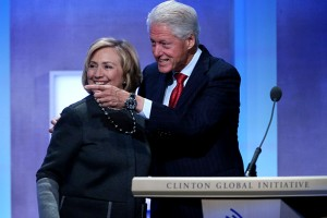 Former Secretary of State Hillary Clinton (L) and former U.S. President Bill Clinton embrace at the opening plenary session of the Clinton Global Initiative (CGI), on September 22, 2014 in New York City. (Photo by John Moore/Getty Images)