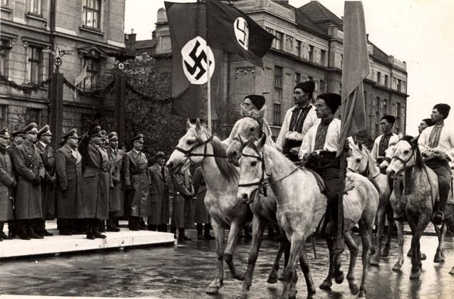 "Ukrainian cavalrymen on parade in front of Hans Frank, Nazi Governor-General of occupied Poland's ""General Government"" territory (Sept 1939, Lviv, Ukraine)."