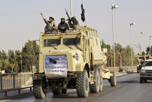 ISIS fighters arrive in Ar-Raqqah, Syria on board of American supplied ex-Iraqi army vehicles.