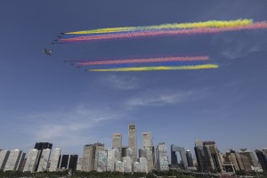 Beijing, September 3, 2015. Chinese military jets parade over Central Business District