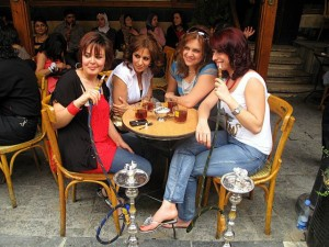 Young women sharing tea and kalian in a shop in Damascus, 2010.