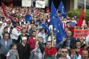 A cocktail of Albanian, EU and US flags in hands of duped Albanian elements in Skopje.
