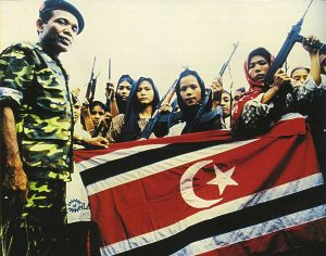 Women soldiers of the Free Aceh Movement with GAM commander Abdullah Syafei'i, 1999