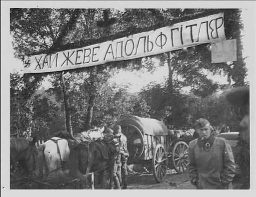 """Long live Adolf Hitler!"" - a banner welcoming visitors to a Ukrainian village during occupation."