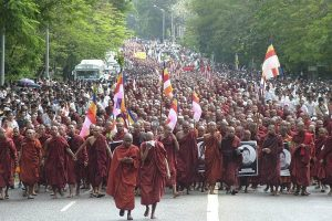 Buddhist monks march on a street in protest against the military government in Yangon, Myanmar, Nov 2011