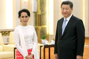 Aung San Suu Kyi and China's President Xi Jinping in Beijing in June 2015