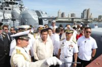 President Rodrigo Duterte (center) visits the Russian anti-submarine ship Admiral Tributs