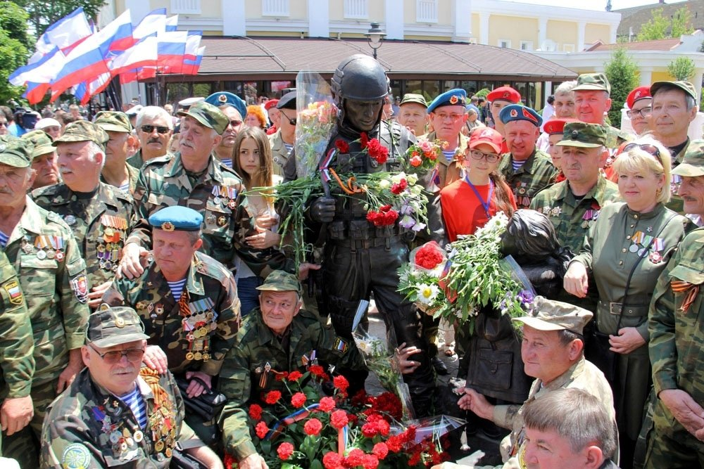 "Russian war veterans meeting by the newly opened monument to ""polite people"" in Crimea."