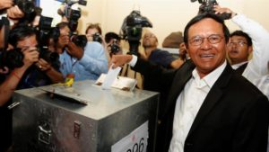 Cambodia National Rescue Party leader Kem Sokha casts his vote during June elections [Samrang Pring/Reuters]