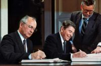 Mikhail Gorbachev (left) and Ronald Reagan signing the Intermediate-Range Nuclear Forces Treaty, Dec 8, 1987