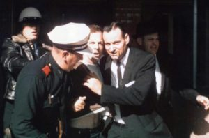 Oswald being led from the Texas Theatre following his arrest
