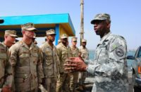 Gen. William 'Kip' Ward, Commander, U.S. Africa Command, talks to Sailors during the establishment of a U.S. military harbor security force at the Port de Djibouti
