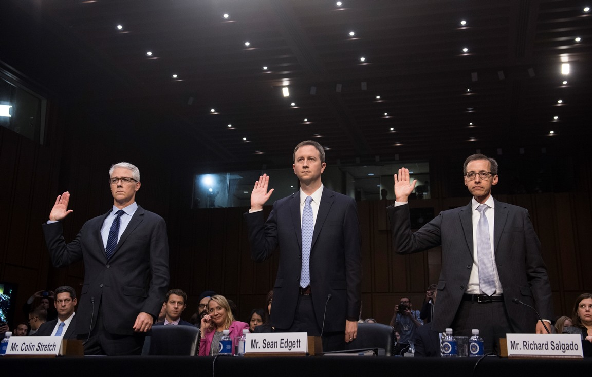 Colin Stretch (L), General Counsel of Facebook, Sean Edgett (C), Acting General Counsel of Twitter, and Richard Salgado (R), Director of Law Enforcement And Information Security of Google, are sworn in prior to testifying during a US Senate Judiciary Subcommittee on Crime and Terrorism hearing on Russian influence on social networks on Capitol Hill in Washington, DC, October 31, 2017.